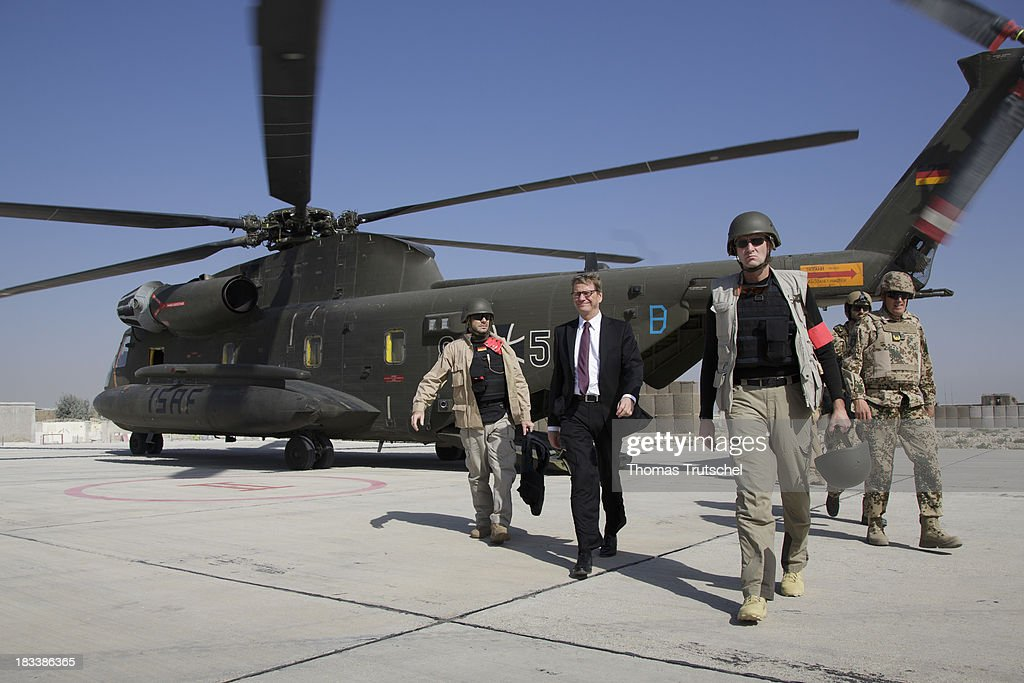 German Foreign Minister Guido Westerwelle leaves a CH-53 Helicopter on his way from Mazar-i Sharif to Kunduz on October 06, 2013 in Mazar-i Sharif, Afghansitan. Westerwelle visits Afghanistan to hand over German PRT in Kunduz to the Afghan Military.