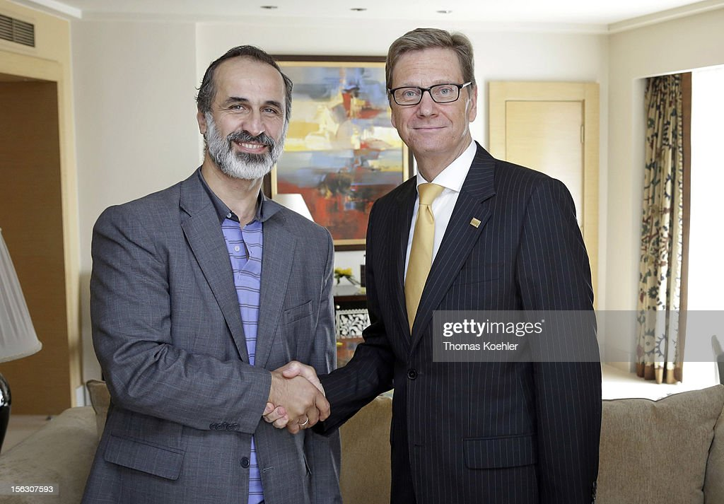 German Foreign Minister <a gi-track='captionPersonalityLinkClicked' href=/galleries/search?phrase=Guido+Westerwelle&family=editorial&specificpeople=208748 ng-click='$event.stopPropagation()'>Guido Westerwelle</a> (R) meets Ahmad Mouaz Al-Khatib (L), leader of National Coalition for Opposition Forces and the Syrian Revolution, before the second Euro - Arab Ministerial Meeting 2012 on November 13, 2012 in Cairo, Egypt.