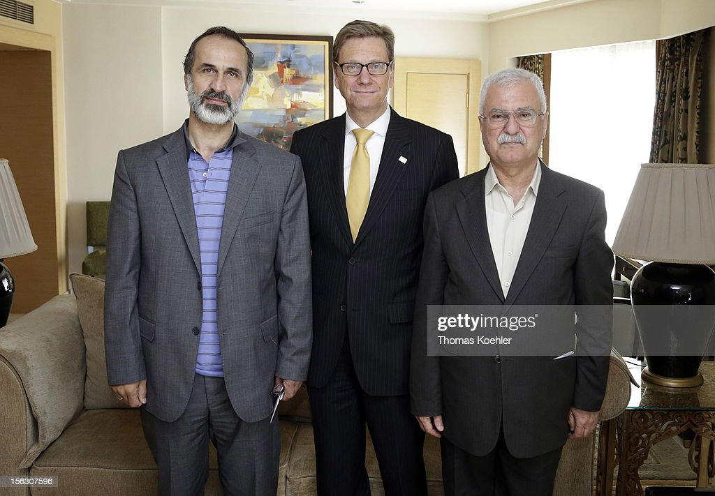 German Foreign Minister <a gi-track='captionPersonalityLinkClicked' href=/galleries/search?phrase=Guido+Westerwelle&family=editorial&specificpeople=208748 ng-click='$event.stopPropagation()'>Guido Westerwelle</a> (C) meets Ahmad Mouaz Al-Khatib (L), leader of National Coalition for Opposition Forces and the Syrian Revolution, and George Sabra (R), president of the Syrian National Council, before the second Euro - Arab Ministerial Meeting 2012 on November 13, 2012 in Cairo, Egypt.