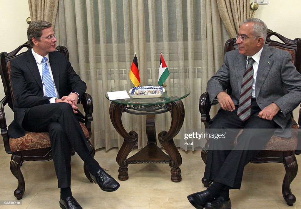 German Foreign Minister <a gi-track='captionPersonalityLinkClicked' href=/galleries/search?phrase=Guido+Westerwelle&family=editorial&specificpeople=208748 ng-click='$event.stopPropagation()'>Guido Westerwelle</a> (L) meets Palestinian Prime Minister Salaam Fayyad (R) during his visit to the West Bank on November 24, 2009 in Ramallah. The new German foreign minister made the short journey to Ramallah from Jerusalem, where after his arrival Monday he made a point of first visiting the Yad Vashem Holocaust memorial before holding talks with Prime Minister Benjamin Netanyahu and dining with Foreign Minister Avigdor Lieberman later in the evening.