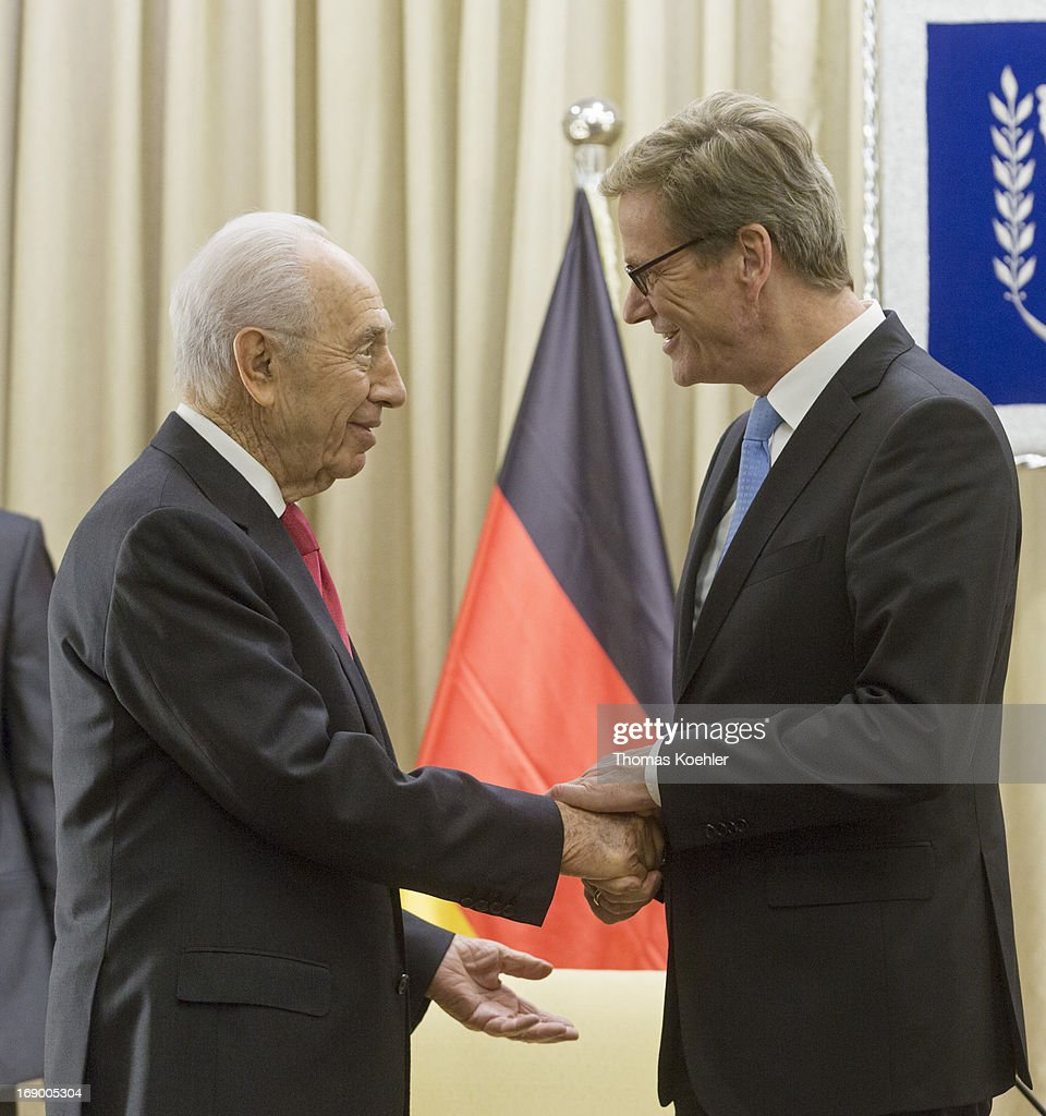 German Foreign Minister <a gi-track='captionPersonalityLinkClicked' href=/galleries/search?phrase=Guido+Westerwelle&family=editorial&specificpeople=208748 ng-click='$event.stopPropagation()'>Guido Westerwelle</a> (R) meets <a gi-track='captionPersonalityLinkClicked' href=/galleries/search?phrase=Shimon+Peres&family=editorial&specificpeople=201775 ng-click='$event.stopPropagation()'>Shimon Peres</a>, President of Israel, on May 17, 2013 in Jerusalem, Israel. The issues topping the agenda are renewed efforts for the Middle East peace process, the crisis in Syria and the Iranian nuclear programme.