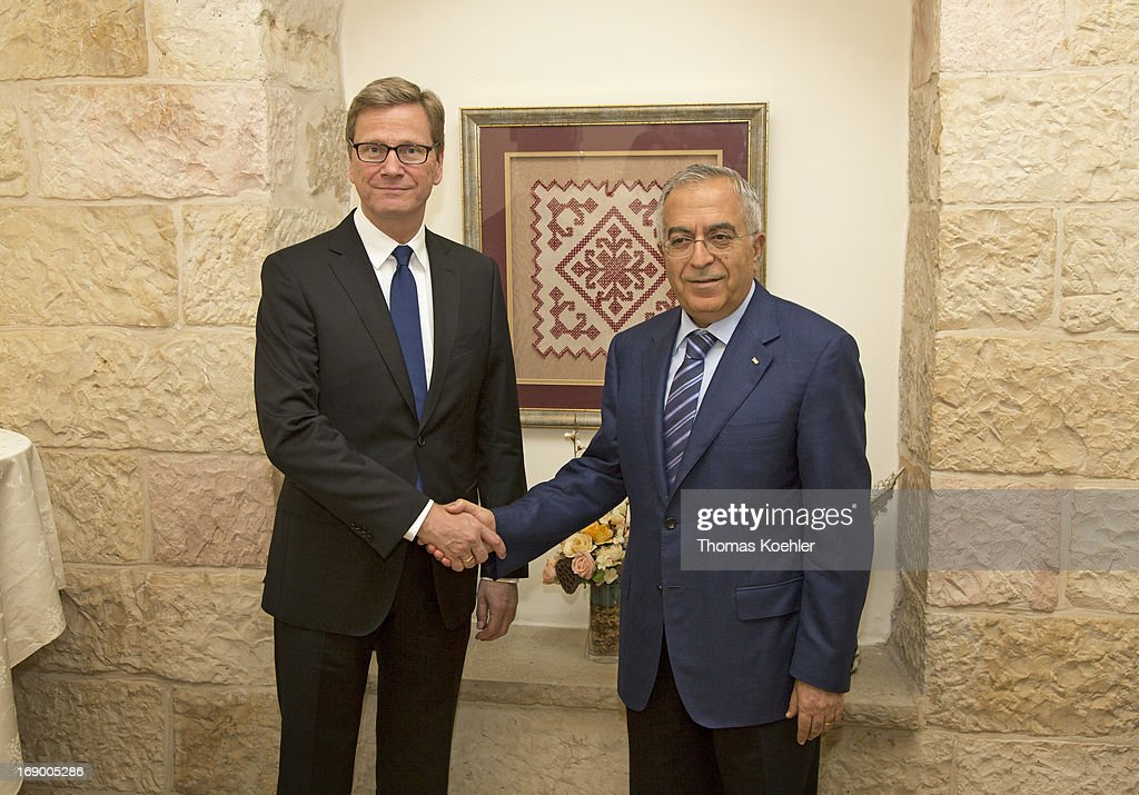 German Foreign Minister Guido Westerwelle (L) meets the Prime Minister of the Palestinian National Authority, Salam Fayyad, on May 18, 2013 in Ramallah, Palestine. The issues topping the agenda are renewed efforts for the Middle East peace process, the crisis in Syria and the Iranian nuclear program.