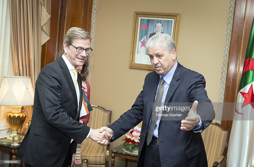 German Foreign Minister <a gi-track='captionPersonalityLinkClicked' href=/galleries/search?phrase=Guido+Westerwelle&family=editorial&specificpeople=208748 ng-click='$event.stopPropagation()'>Guido Westerwelle</a> (L) meets with Abdelmalek Sellal, Prime Minister of Algeria, on May 19, 2013 in Algiers, Algeria. The issues topping the agenda are renewed efforts for the Middle East peace process, the crisis in Syria and the Iranian nuclear program.