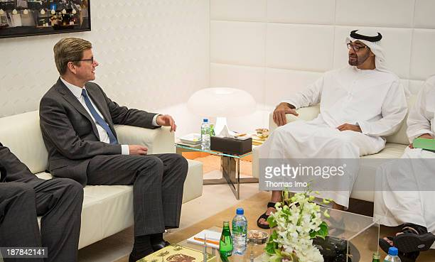 German Foreign Minister Guido Westerwelle meets with Abu Dhabi Crown Prince Sheikh Mohammed Bin Zayed Al Nahyan on November 13 2013 in Abu Dhabi...