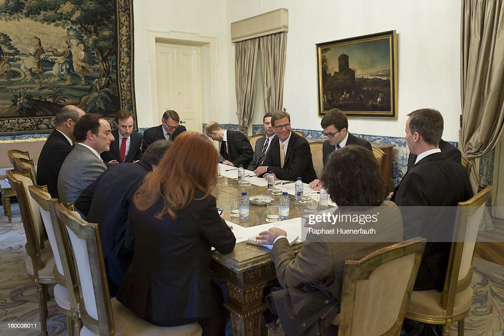 German Foreign Minister <a gi-track='captionPersonalityLinkClicked' href=/galleries/search?phrase=Guido+Westerwelle&family=editorial&specificpeople=208748 ng-click='$event.stopPropagation()'>Guido Westerwelle</a> (C) meets with his Spanish counterpart Paulo Portas (L), at the the Ministry for Foreign Affairs, on January 24, 2013 in Lisbon, Portugal. Westerwelle has scheduled meetings with Portugese Foreign Minister Portas and Prime Minister Coelho. Westerwelle will attend the first German-Portuguese Forum.