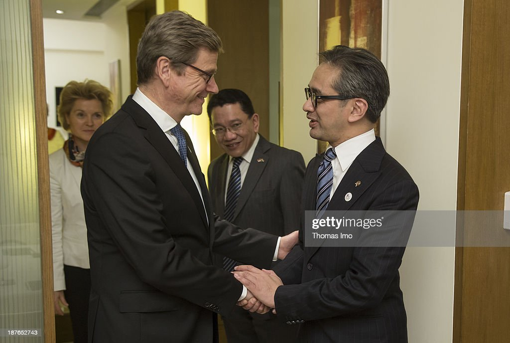 German Foreign Minister <a gi-track='captionPersonalityLinkClicked' href=/galleries/search?phrase=Guido+Westerwelle&family=editorial&specificpeople=208748 ng-click='$event.stopPropagation()'>Guido Westerwelle</a> (L) meets with <a gi-track='captionPersonalityLinkClicked' href=/galleries/search?phrase=Marty+Natalegawa&family=editorial&specificpeople=2862416 ng-click='$event.stopPropagation()'>Marty Natalegawa</a>, Minister of Foreign Affairs of Indonesia, during a meeting of the ASEM foreign ministers on November 11, 2013 in New Delhi, India. The ASEM offers a platform for an informal process of dialogue, bringing together European countries and the European Commission with Asian countries. The 11th ASEM Foreign Minister' meeting is using the proposed theme 'Bridge to Partnership for Growth and Development' as its platform.