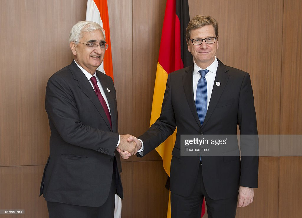 German Foreign Minister Guido Westerwelle (R) meets with Salman Khurshid, Minister of External Affairs of India, during a meeting of the ASEM foreign ministers on November 11, 2013 in New Delhi, India. The ASEM offers a platform for an informal process of dialogue, bringing together European countries and the European Commission with Asian countries. The 11th ASEM Foreign Minister' meeting is using the proposed theme 'Bridge to Partnership for Growth and Development' as its platform.