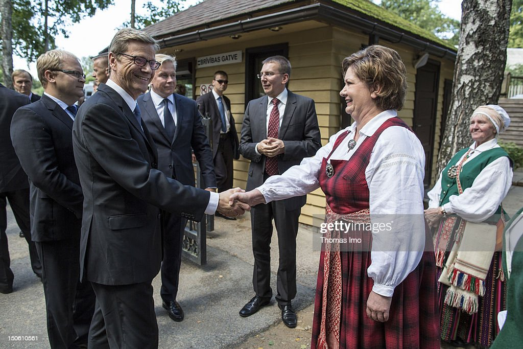 German Foreign Minister Guido Westerwelle (in the front), Minister of Foreign Affairs of Estonia Urmas Paet, Foreign Minister of Lithuania Audronius Azubalis and Foreign Minister of Latvia Edgars Rinkevics visit LATVIAN OPEN-AIR ETHNOGRAPHIC MUSEUM on August 23, 2012 in Riga, Latvia. The ministers take part in the regular political consultations between the Baltic States and Germany, the so-called 3+1 consultations.