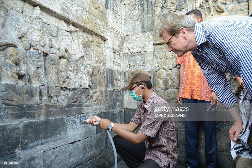German Foreign Minister Guido Westerwelle observes the conservation work during a visit to the ancient Borobudur temple located in Magelang, in Eeast Java province on February 10, 2013. A UNESCO world heritage site, the Buddhist temple was built in the eigth century. Westerwelle is on a two day visit to Indonesia as part of his Southeast Asian tour.