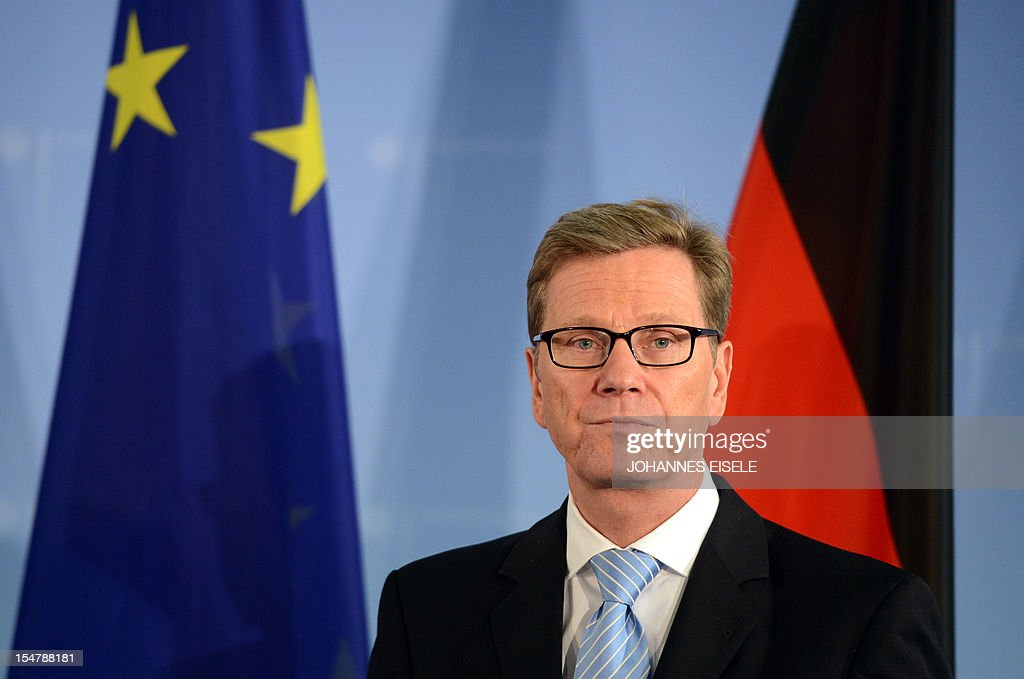 German Foreign Minister Guido Westerwelle poses for a photo after addressing a press conference on October 26, 2012 in Berlin. Irish Foreign Minister Eamon Gilmore said his country aimed to be the first of the struggling eurozone nations to exit a bailout programme as his German counterpart hailed Ireland's 'success story.'