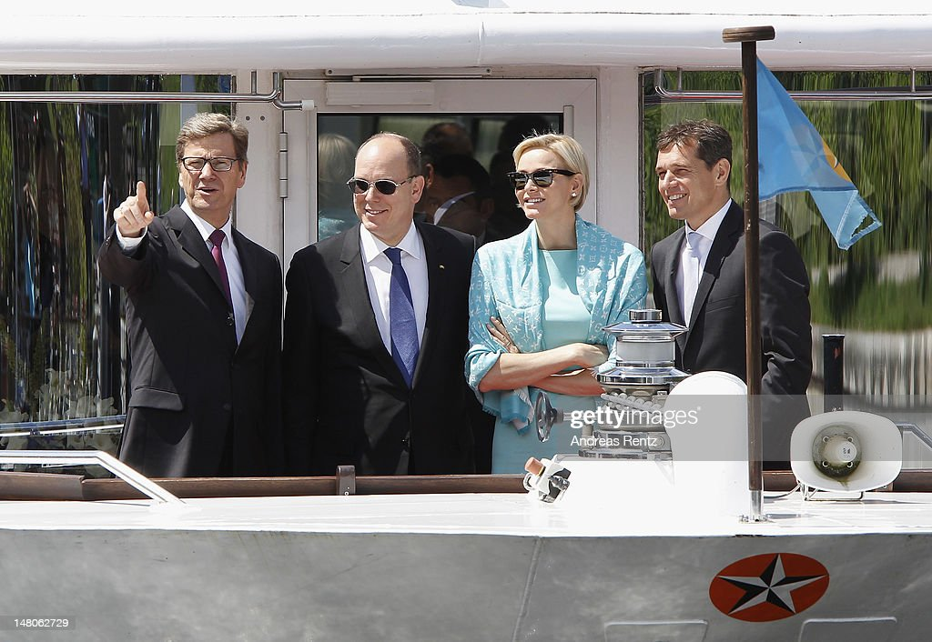 German Foreign Minister <a gi-track='captionPersonalityLinkClicked' href=/galleries/search?phrase=Guido+Westerwelle&family=editorial&specificpeople=208748 ng-click='$event.stopPropagation()'>Guido Westerwelle</a>, Prince Albert II with Princess <a gi-track='captionPersonalityLinkClicked' href=/galleries/search?phrase=Charlene+-+Princesa+de+M%C3%B3naco&family=editorial&specificpeople=726115 ng-click='$event.stopPropagation()'>Charlene</a> of Monaco and <a gi-track='captionPersonalityLinkClicked' href=/galleries/search?phrase=Michael+Mronz&family=editorial&specificpeople=762924 ng-click='$event.stopPropagation()'>Michael Mronz</a> smile during a boat tour on the Spree canal on July 9, 2012 in Berlin, Germany. Prince Albert II and Princess <a gi-track='captionPersonalityLinkClicked' href=/galleries/search?phrase=Charlene+-+Princesa+de+M%C3%B3naco&family=editorial&specificpeople=726115 ng-click='$event.stopPropagation()'>Charlene</a> are visiting Berlin and tomorrow will continue to Stuttgart.