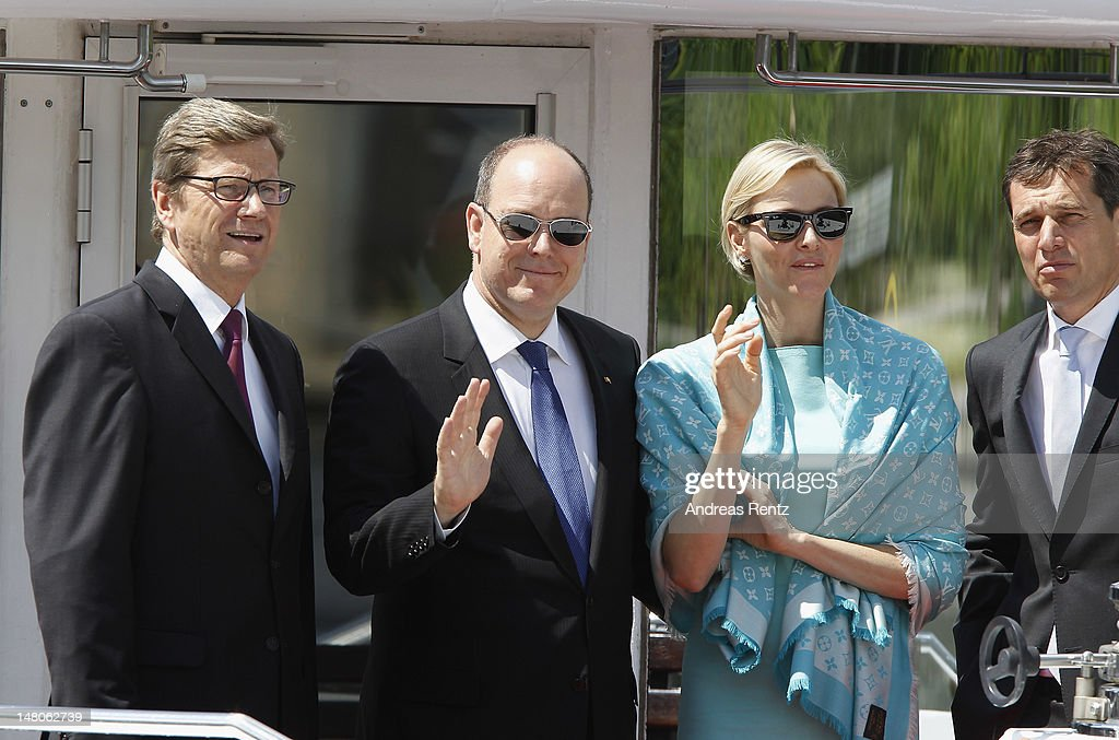 German Foreign Minister <a gi-track='captionPersonalityLinkClicked' href=/galleries/search?phrase=Guido+Westerwelle&family=editorial&specificpeople=208748 ng-click='$event.stopPropagation()'>Guido Westerwelle</a>, Prince Albert II with Princess <a gi-track='captionPersonalityLinkClicked' href=/galleries/search?phrase=Charlene+-+Princesa+do+M%C3%B3naco&family=editorial&specificpeople=726115 ng-click='$event.stopPropagation()'>Charlene</a> of Monaco and <a gi-track='captionPersonalityLinkClicked' href=/galleries/search?phrase=Michael+Mronz&family=editorial&specificpeople=762924 ng-click='$event.stopPropagation()'>Michael Mronz</a> smile during a boat tour on the Spree canal on July 9, 2012 in Berlin, Germany. Prince Albert II and Princess <a gi-track='captionPersonalityLinkClicked' href=/galleries/search?phrase=Charlene+-+Princesa+do+M%C3%B3naco&family=editorial&specificpeople=726115 ng-click='$event.stopPropagation()'>Charlene</a> are visiting Berlin and tomorrow will continue to Stuttgart.