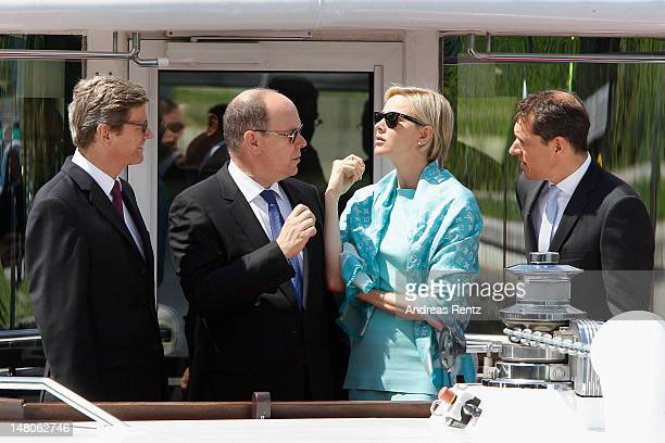 German Foreign Minister Guido Westerwelle Prince Albert II with Princess Charlene of Monaco and Michael Mronz smile during a boat tour on the Spree...