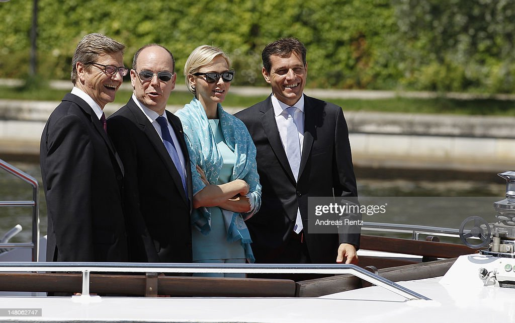 German Foreign Minister <a gi-track='captionPersonalityLinkClicked' href=/galleries/search?phrase=Guido+Westerwelle&family=editorial&specificpeople=208748 ng-click='$event.stopPropagation()'>Guido Westerwelle</a>, Prince Albert II with Princess <a gi-track='captionPersonalityLinkClicked' href=/galleries/search?phrase=Charlene+-+Principessa+di+Monaco&family=editorial&specificpeople=726115 ng-click='$event.stopPropagation()'>Charlene</a> of Monaco and <a gi-track='captionPersonalityLinkClicked' href=/galleries/search?phrase=Michael+Mronz&family=editorial&specificpeople=762924 ng-click='$event.stopPropagation()'>Michael Mronz</a> smile during a boat tour on the Spree canal on July 9, 2012 in Berlin, Germany. Prince Albert II and Princess <a gi-track='captionPersonalityLinkClicked' href=/galleries/search?phrase=Charlene+-+Principessa+di+Monaco&family=editorial&specificpeople=726115 ng-click='$event.stopPropagation()'>Charlene</a> are visiting Berlin and tomorrow will continue to Stuttgart.