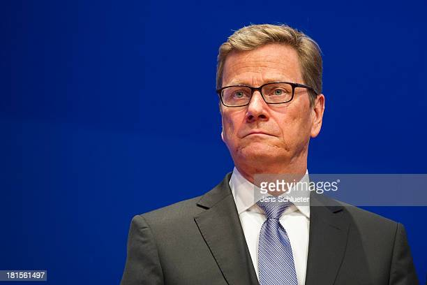 German Foreign minister Guido Westerwelle reacts to the initial exit polls results that give the party 46% of the vote on the stage at FDP party...
