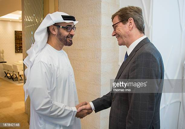German Foreign Minister Guido Westerwelle shakes hands with Abu Dhabi Crown Prince Sheikh Mohammed Bin Zayed Al Nahyan on November 13 2013 in Abu...