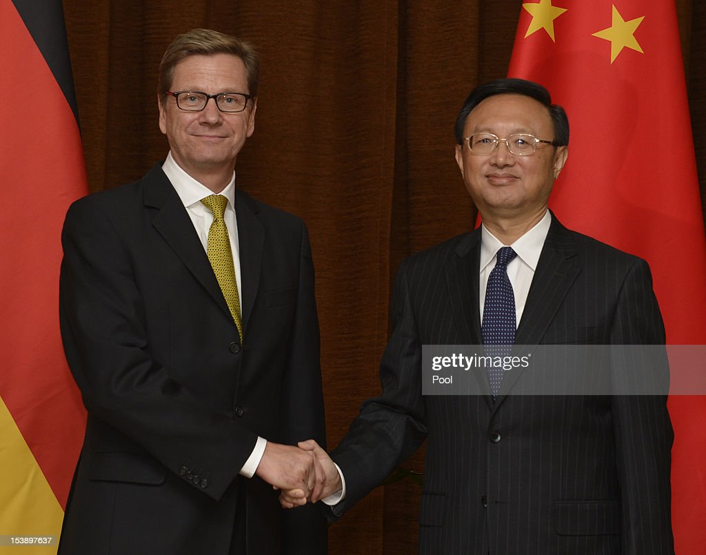 German Foreign Minister <a gi-track='captionPersonalityLinkClicked' href=/galleries/search?phrase=Guido+Westerwelle&family=editorial&specificpeople=208748 ng-click='$event.stopPropagation()'>Guido Westerwelle</a> (L) shakes hands with Chinese Foreign Minister <a gi-track='captionPersonalityLinkClicked' href=/galleries/search?phrase=Yang+Jiechi&family=editorial&specificpeople=555098 ng-click='$event.stopPropagation()'>Yang Jiechi</a> ahead of their meeting on October 11, 2012 in Beijing, China. Westerwelle is visiting China from October 11-13 to further promote bilateral ties during a year that marks 40 years of diplomatic relations between the two countries.