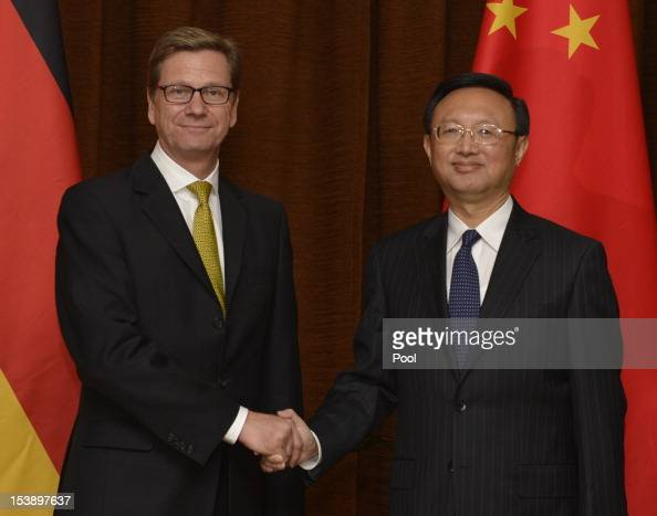 German Foreign Minister Guido Westerwelle shakes hands with Chinese Foreign Minister Yang Jiechi ahead of their meeting on October 11 2012 in Beijing...
