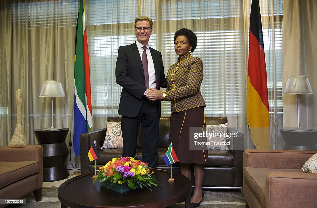 German Foreign Minister Guido Westerwelle (L) shakes hands with Foreign Minister of South Africa, Maite Nkoana-Mashabane on April 29, 2013 in Pretoria, South Africa. Westerwelle is on a four day trip to Africa with Stops in Ghana, South Africa and Mozambique.