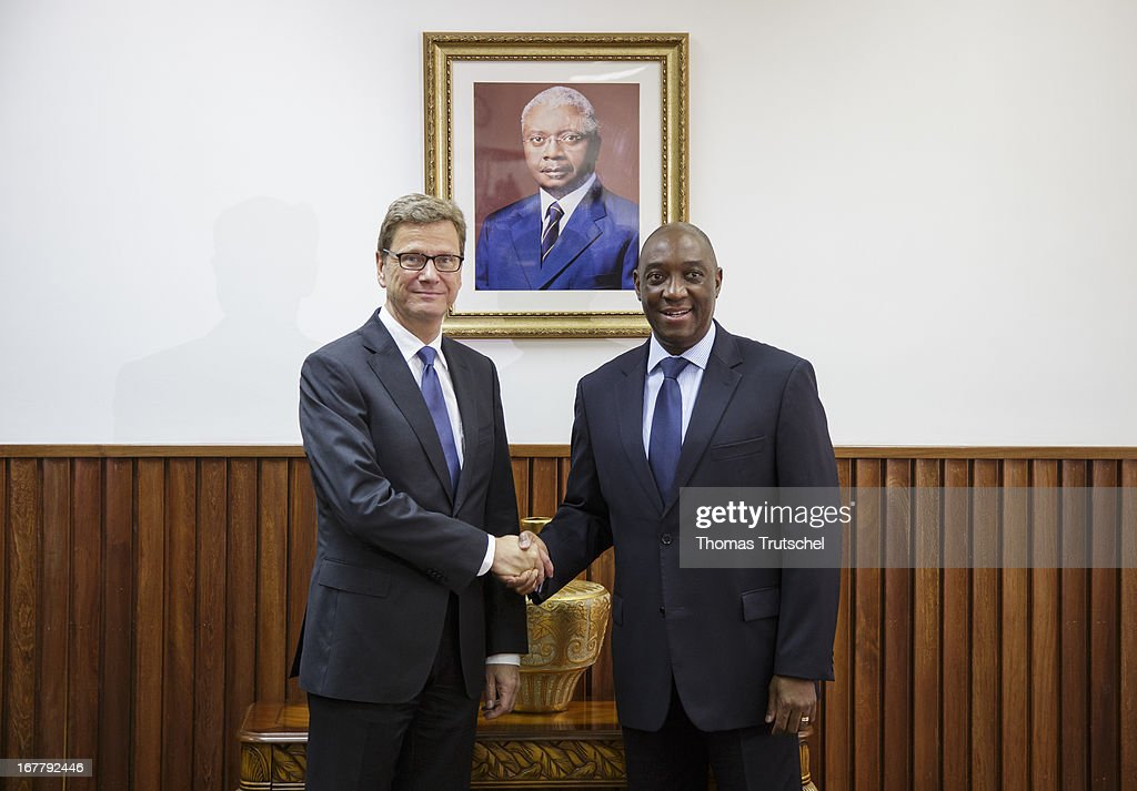 German Foreign Minister <a gi-track='captionPersonalityLinkClicked' href=/galleries/search?phrase=Guido+Westerwelle&family=editorial&specificpeople=208748 ng-click='$event.stopPropagation()'>Guido Westerwelle</a> shakes hands with Foreign Minister of Mozambique, Oldemiro Baloi on April 30, 2013 in Maputo, Mozambique. Westerwelle is on a four-day trip to Africa with stops in Ghana, South Africa and Mozambique.