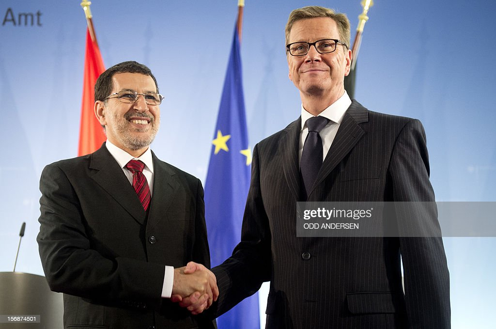 CORRECTION - German foreign minister Guido Westerwelle (R) shakes hands with his Moroccan counterpart Saad-Eddine El Othmani after a press conference at the foreign ministry in Berlin on November 23, 2012. The two ministers discussed the ongoing hostilities in Syria and expressed hope for the ceasefire between Hamas and Israel.