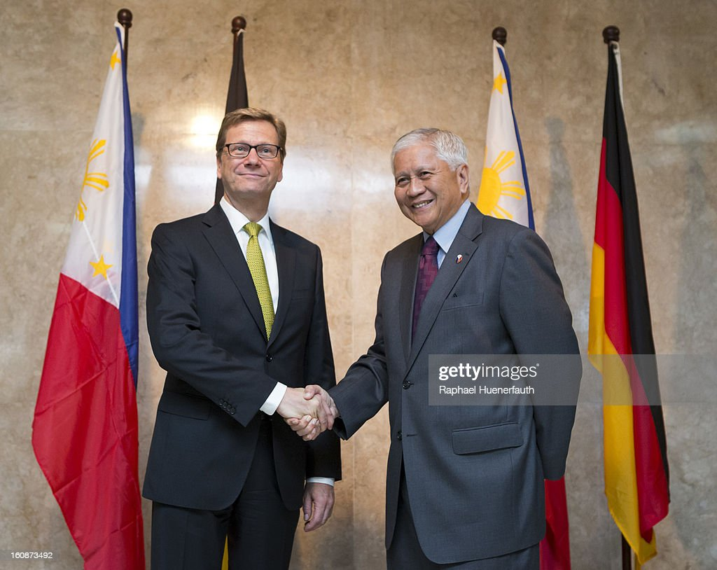German Foreign Minister <a gi-track='captionPersonalityLinkClicked' href=/galleries/search?phrase=Guido+Westerwelle&family=editorial&specificpeople=208748 ng-click='$event.stopPropagation()'>Guido Westerwelle</a> (L) shakes hands with his counterpart from the Philippines Albert F. del Rosario (R), at the foreign ministry on February 7, 2013 in Manila, Philippines. Westerwelle, who is the first German Foreign Minister to visit the Philippines in more than twelve years, is in Manila to discuss bilateral trade and relations accompanied by a 12-man business delegation.