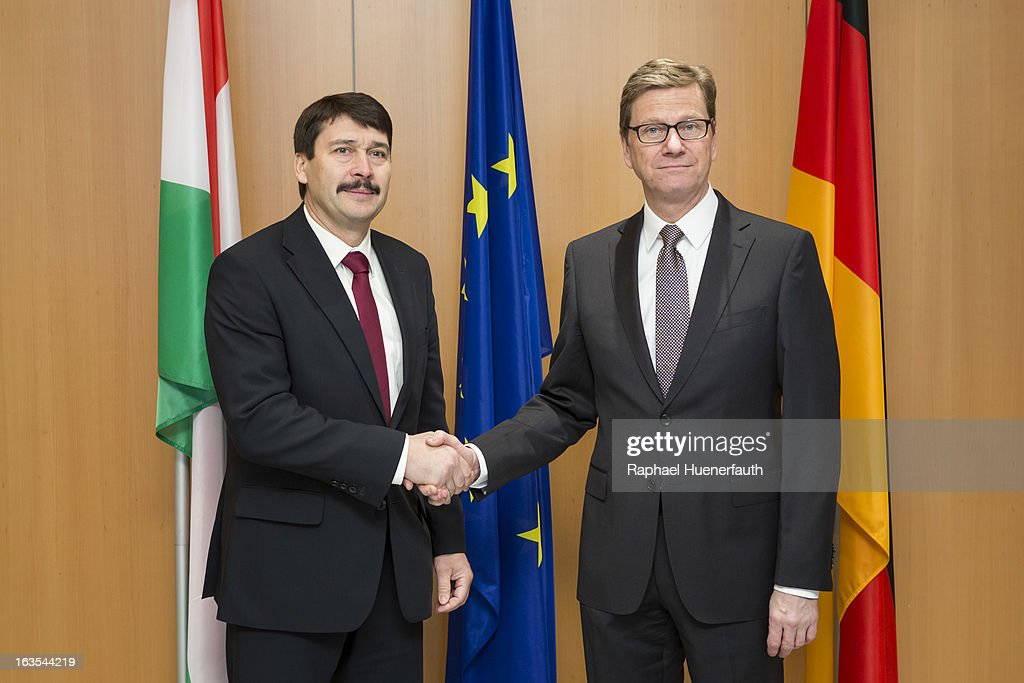 German Foreign Minister Guido Westerwelle shakes hands with Hungarian President Janos Ader (L) at the Hungarian Embassy on March 12 , 2013 in Berlin, Germany. The Hungarian president is holding talks with Chancellor Angela Merkel German Foreign Minister Guido Westerwelle on the second day of his two-day official visit to Germany.