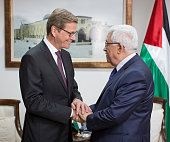 German Foreign Minister Guido Westerwelle shakes hands with Palestinian President Mahmoud Abbas on August 12 2013 in Ramallah West Bank Westerwelle...