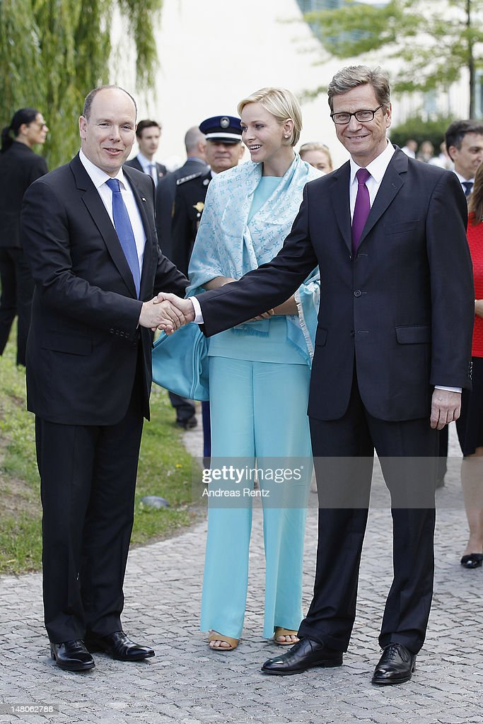 German Foreign Minister <a gi-track='captionPersonalityLinkClicked' href=/galleries/search?phrase=Guido+Westerwelle&family=editorial&specificpeople=208748 ng-click='$event.stopPropagation()'>Guido Westerwelle</a> (R) shakes hands with Prince Albert II as Princess Charlene of Monaco smiles upon their arrival for a boat tour on the Spree canal on July 9, 2012 in Berlin, Germany. Prince Albert II and Princess Charlene are visiting Berlin and tomorrow will continue to Stuttgart.