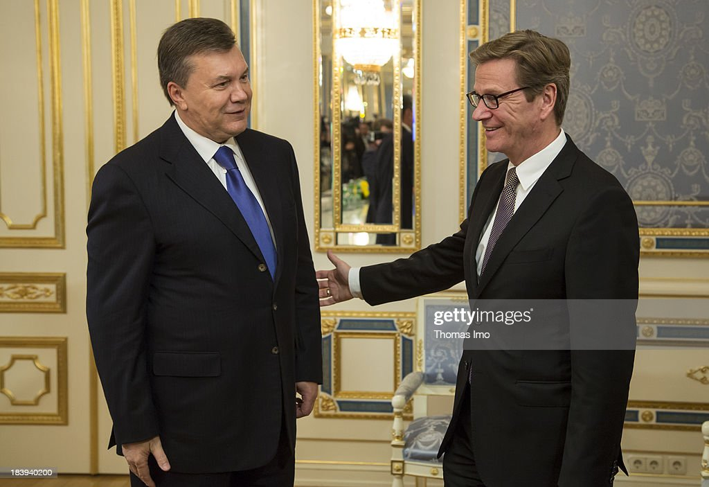 German Foreign Minister <a gi-track='captionPersonalityLinkClicked' href=/galleries/search?phrase=Guido+Westerwelle&family=editorial&specificpeople=208748 ng-click='$event.stopPropagation()'>Guido Westerwelle</a> ( R) shakes hands with Ukrainian President <a gi-track='captionPersonalityLinkClicked' href=/galleries/search?phrase=Viktor+Yanukovych&family=editorial&specificpeople=717883 ng-click='$event.stopPropagation()'>Viktor Yanukovych</a> on October 10, 2013 in Kiev, Ukraine. Westerwelle is on a two-day trip in kiev, for bilateral meetings and to attend the international conference 'The Way Ahead for the Eastern Partnership'.