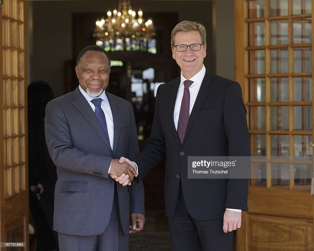 German Foreign Minister Guido Westerwelle (R) shakes hands with Vice President of South Africa, Kgalema Motlanthe on April 29, 2013 in Pretoria, South Africa. Westerwelle is on a four day trip to Africa with stops in Ghana, South Africa and Mozambique.
