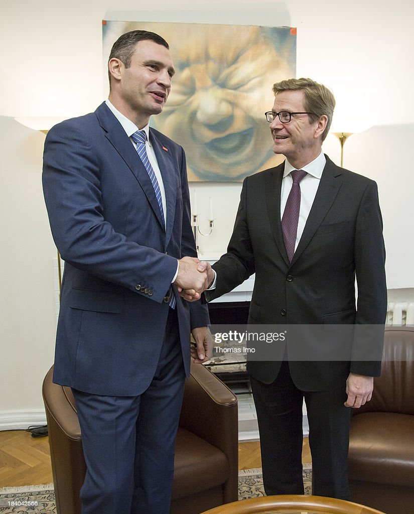 German Foreign Minister Guido Westerwelle shakes hands with Vitali Klitschko, leader of Ukraine's UDAR opposition party, on October 11, 2013 in Kiev, Ukraine. Westerwelle is on a two-day trip in kiev, for bilateral meetings and to attend the international conference 'The Way Ahead for the Eastern Partnership'.