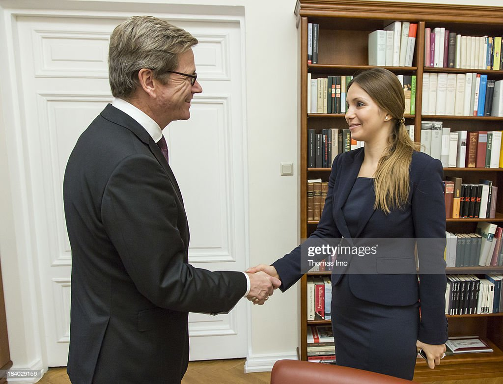 German Foreign Minister <a gi-track='captionPersonalityLinkClicked' href=/galleries/search?phrase=Guido+Westerwelle&family=editorial&specificpeople=208748 ng-click='$event.stopPropagation()'>Guido Westerwelle</a> shakes hands with Yevgeniya Tymoshenko, the daughter of Ukraine's former prime minister Yulia Tymoshenko on October 11, 2013 in Kiev, Ukraine. Westerwelle is on a two-day trip in kiev, for bilateral meetings and to attend the international conference 'The Way Ahead for the Eastern Partnership'.