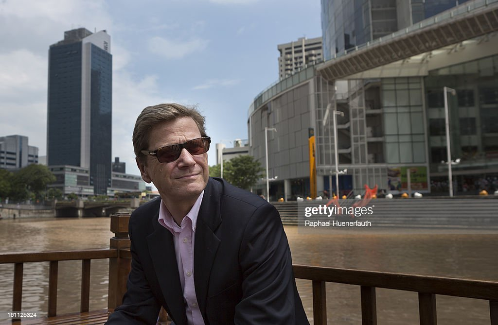 German Foreign Minister <a gi-track='captionPersonalityLinkClicked' href=/galleries/search?phrase=Guido+Westerwelle&family=editorial&specificpeople=208748 ng-click='$event.stopPropagation()'>Guido Westerwelle</a> sits by Singapore River on February 9, 2013 in Singapore. Westerwelle is in Singapore to hold talks aimed at expanding free trade and build on economic collaboration with Southeast Asian nations.