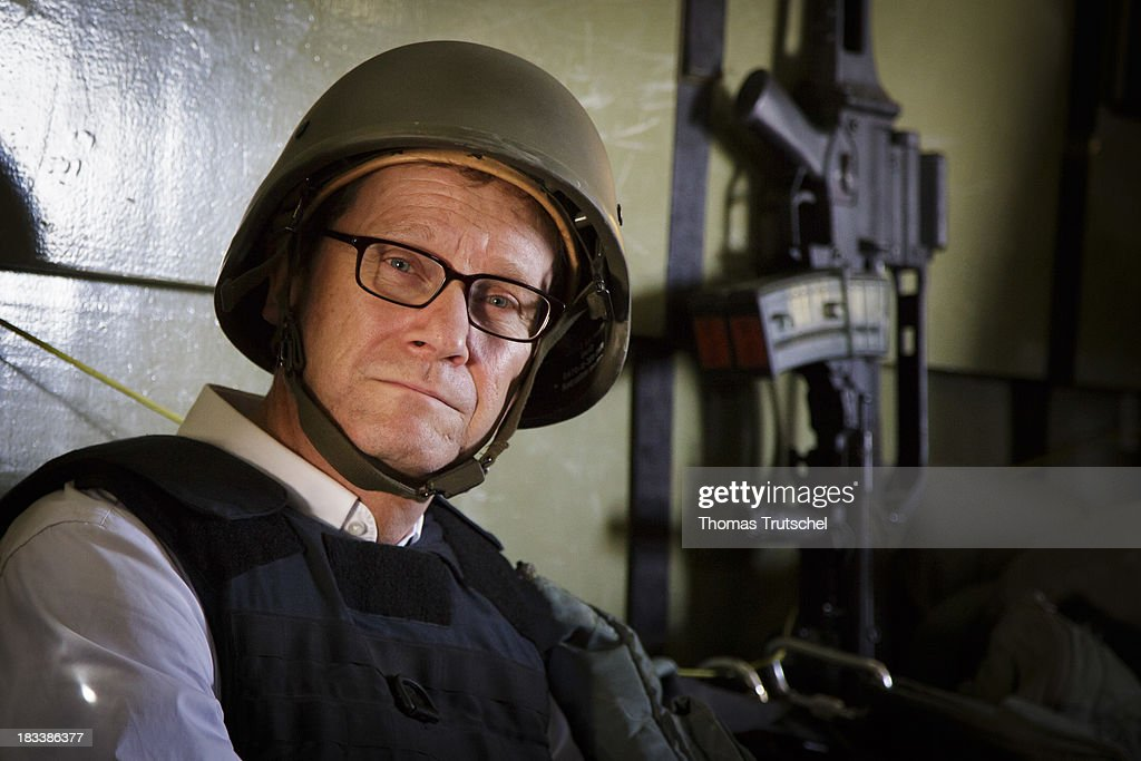 German Foreign Minister <a gi-track='captionPersonalityLinkClicked' href=/galleries/search?phrase=Guido+Westerwelle&family=editorial&specificpeople=208748 ng-click='$event.stopPropagation()'>Guido Westerwelle</a> sits in a CH-53 Helicopter on his way from Mazar-i Sharif to Kunduz on October 06, 2013 in Mazar-i Sharif, Afghansitan. Westerwelle visits Afghanistan to hand over German PRT in Kunduz to the Afghan Military.