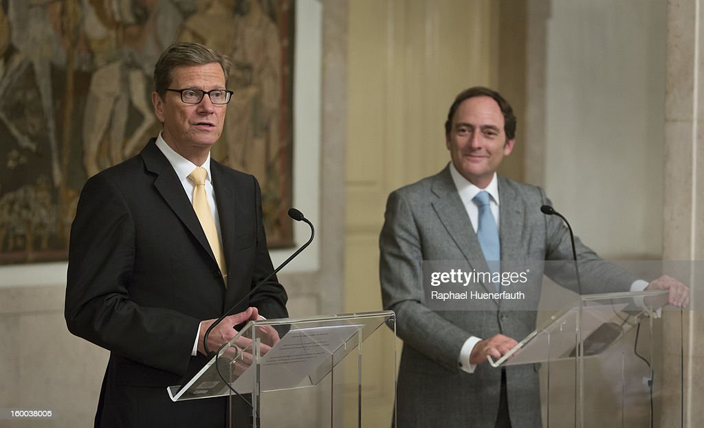 German Foreign Minister <a gi-track='captionPersonalityLinkClicked' href=/galleries/search?phrase=Guido+Westerwelle&family=editorial&specificpeople=208748 ng-click='$event.stopPropagation()'>Guido Westerwelle</a> (L) speak at a joint press conference with his Spanish counterpart Paulo Portas (R), at the the Ministry for Foreign Affairs, on January 24, 2013 in Lisbon, Portugal. Westerwelle has scheduled meetings with Portugese Foreign Minister Portas and Prime Minister Coelho. Westerwelle will attend the first German-Portuguese Forum.