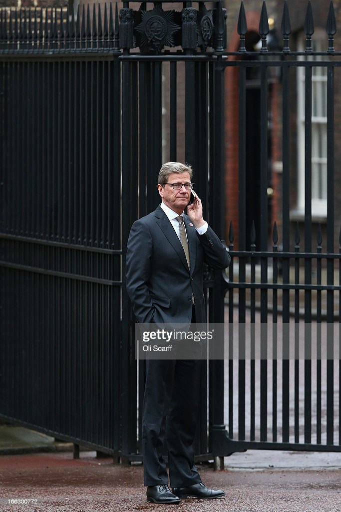 German Foreign Minister Guido Westerwelle speaks on his mobile phone outside Lancaster House on April 11, 2013 in London, England. G8 Foreign Ministers are holding a two day meeting where they will discuss the situation in the Middle East; including Syria and Iran, security and stability across North and West Africa, Democratic People's Republic of Korea and climate change. British Foreign Secretary William Hague will also highlight five key policy priorities.