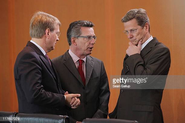 German Foreign Minister Guido Westerwelle speaks to Defense Minister Thomas de Maiziere and Minister of the Chancellery Ronald Pofalla prior to the...