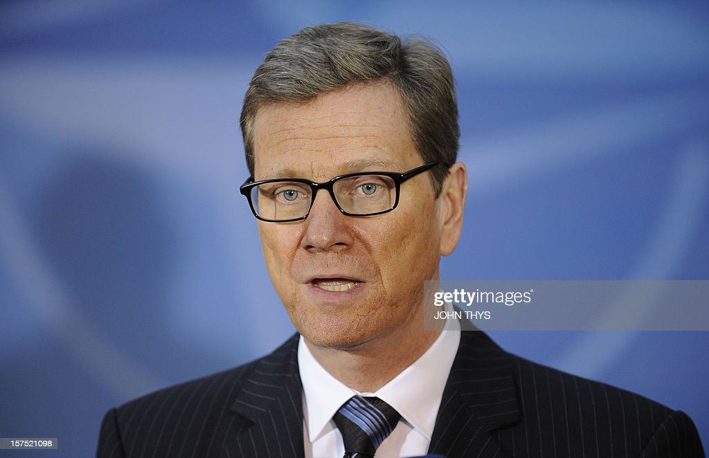 German Foreign Minister Guido Westerwelle speaks to the press as he arrives on December 4, 2012 for a meeting of foreign ministers from the 28 North Atlantic Treaty Organization (NATO) member-countries at organization headquarters in Brussels on Syria and Turkey's request for Patriot missiles to be deployed protectively on the Turkish-Syrian border. AFP PHOTO / JOHN THYS
