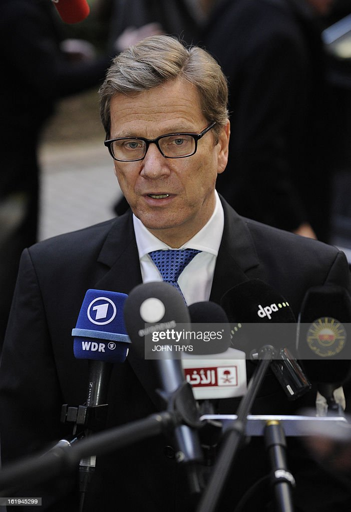 German Foreign minister Guido Westerwelle speaks to the press before a Foreign Affairs Council at the EU Headquarters in Brussels on February 18, 2013. European foreign ministers discuss renewing sanctions on Syria and the possibly of lifting an arms embargo. Talks will also focus on the Mali crisis and Zimbabwe.