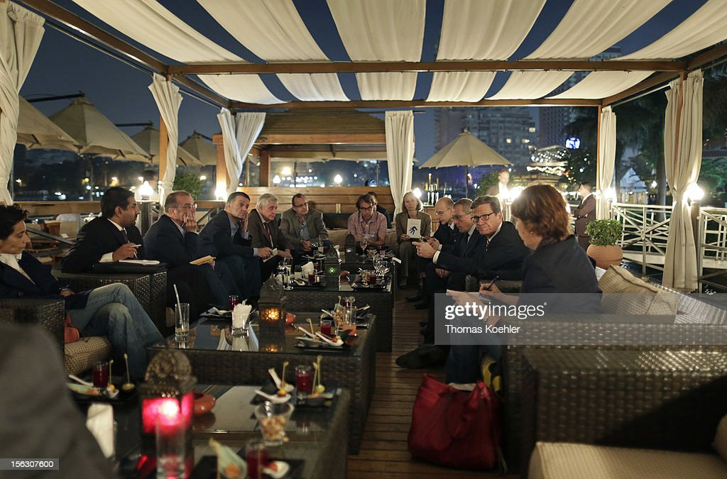German Foreign Minister <a gi-track='captionPersonalityLinkClicked' href=/galleries/search?phrase=Guido+Westerwelle&family=editorial&specificpeople=208748 ng-click='$event.stopPropagation()'>Guido Westerwelle</a> speaks with journalists at the Nile on the terrace of Sofitel, before the second Euro - Arab Ministerial Meeting 2012 on November 12, 2012 in Cairo, Egypt.