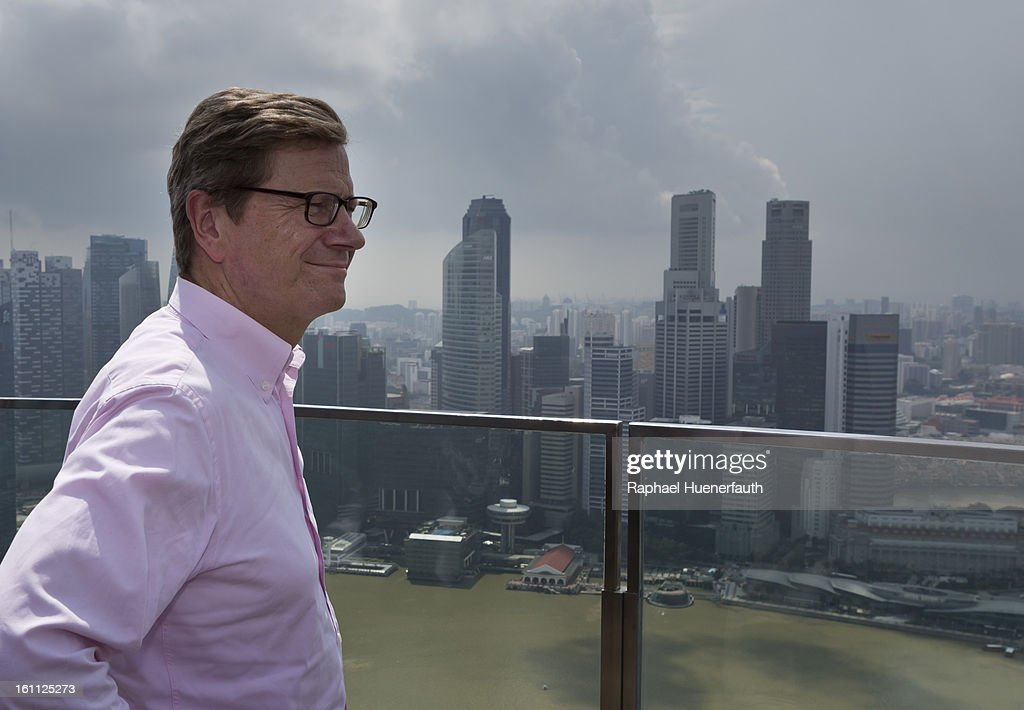 German Foreign Minister Guido Westerwelle stands on the Sands SkyPark, the rooftop garden of the 'Marina Bay Sands Hotel', and looks over the city on February 9, 2013 in Singapore. Westerwelle is in Singapore to hold talks aimed at expanding free trade and build on economic collaboration with Southeast Asian nations.