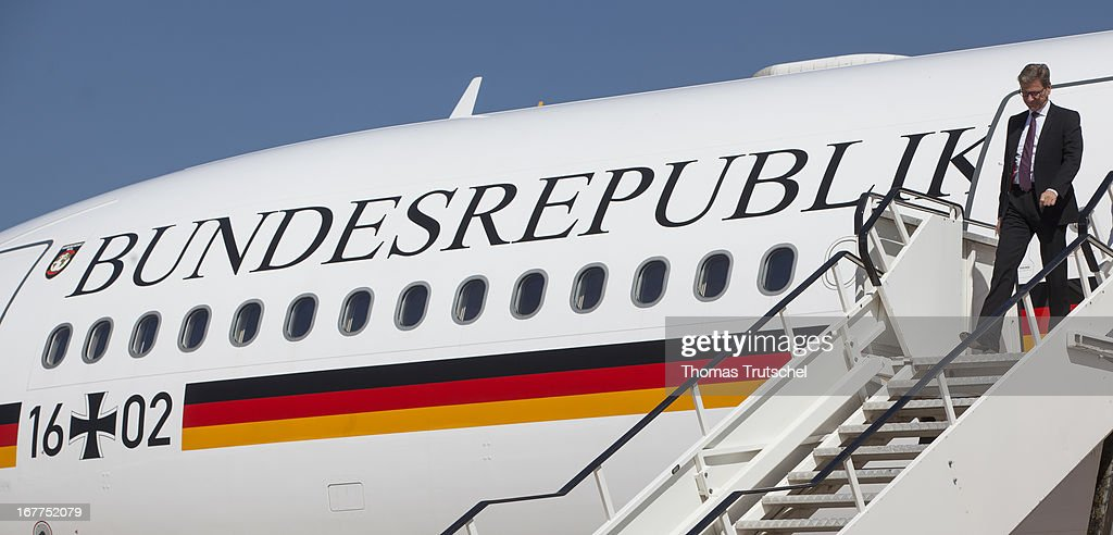 German Foreign Minister <a gi-track='captionPersonalityLinkClicked' href=/galleries/search?phrase=Guido+Westerwelle&family=editorial&specificpeople=208748 ng-click='$event.stopPropagation()'>Guido Westerwelle</a> steps from the plane as he arrives at Waterkloof Airport on April 29, 2013 in Pretoria, South Africa. Westerwelle is on a four day trip to Ghana, South Africa and Mozambique.
