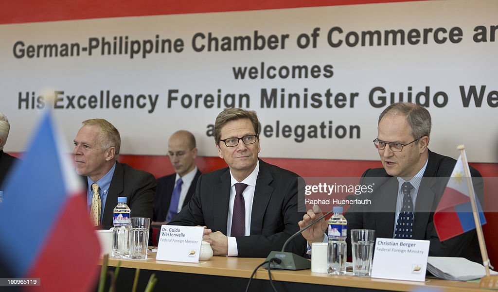 German Foreign Minister Guido Westerwelle (C) takes part at the Economic Roundtable of the German-Philippine Chamber of Commerce and Trade (GPCCI), next to him German Ambassador in the Philippines Joachim Heidorn (L) and Christian Berger (R), from the German Foreign Ministry on February 8, 2013 in Manila, Philippines. Westerwelle, who is the first German Foreign Minister to visit the Philippines in more than twelve years, is in Manila to discuss bilateral trade and relations accompanied by a 12-man business delegation.