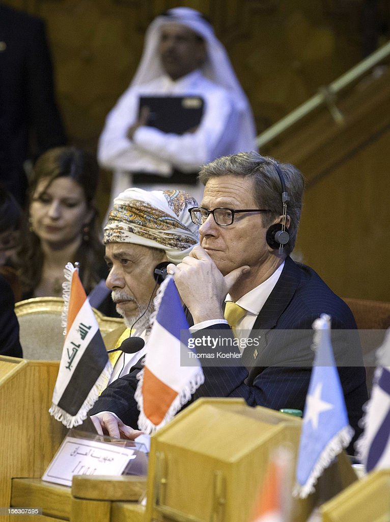 German Foreign Minister <a gi-track='captionPersonalityLinkClicked' href=/galleries/search?phrase=Guido+Westerwelle&family=editorial&specificpeople=208748 ng-click='$event.stopPropagation()'>Guido Westerwelle</a> (R) takes part at the second Euro - Arab Ministerial Meeting 2012 on November 13, 2012 in Cairo, Egypt.