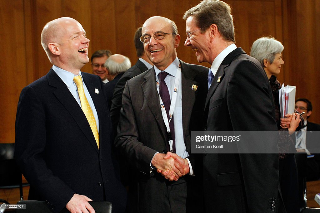 German Foreign Minister Guido Westerwelle (R) talks with French Minister of foreign affairs Alain Juppe (C) and U.K. Foreign Secretary William Hague (L) at an informal meeting of NATO member foreign ministers on April 15, 2011 in Berlin, Germany. The principal focus of the two-day meeting is the alliance's military involvement in the war in Libya, though it also includes special roundtables on the alliance's relationship to Russia, Ukraine and Georgia.