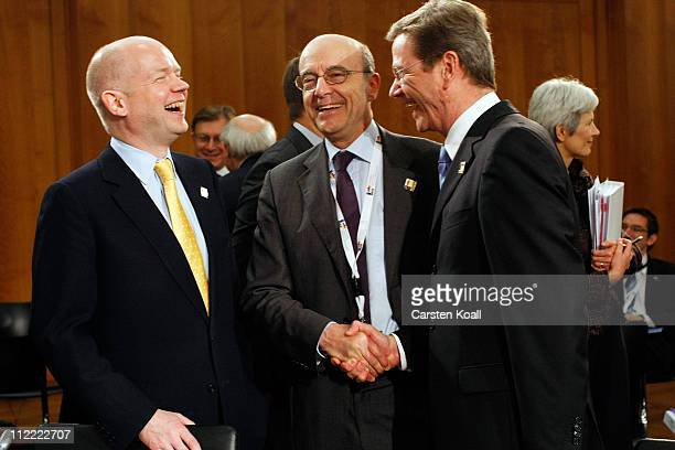 German Foreign Minister Guido Westerwelle talks with French Minister of foreign affairs Alain Juppe and UK Foreign Secretary William Hague at an...
