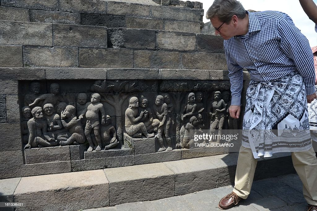 German Foreign Minister Guido Westerwelle visits the ancient Borobudur temple located in Magelang, in Eeast Java province on February 10, 2013. A UNESCO world heritage site, the Buddhist temple was built in the eigth century. Westerwelle is on a two day visit to Indonesia as part of his Southeast Asian tour.