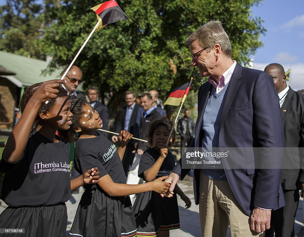 German Foreign Minister <a gi-track='captionPersonalityLinkClicked' href=/galleries/search?phrase=Guido+Westerwelle&family=editorial&specificpeople=208748 ng-click='$event.stopPropagation()'>Guido Westerwelle</a> visits the iThemba Labantu Lutheran Community Center in Philippi Township on April 28, 2013 in Cape Town, South Africa. Westerwelle is on a four day trip to Africa, during which he will visit Ghana, South Africa and Mozambique.