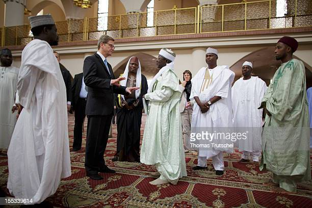 ABUJA NIGERIA NOVEMBER 03 German Foreign Minister Guido Westerwelle visits the national mosque of Nigeria on November 03 2012 in Abuja Nigeria During...